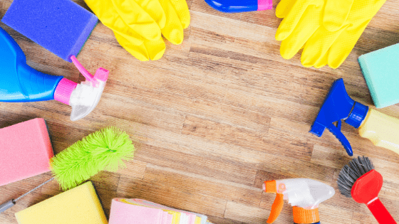 Photo is a bunch of cleaning supplies. Photo is for a blog post on how to stay motivated while spring cleaning by Memories & Words.